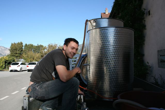 Leo, the intern from Alsace, transferring wine into barrels